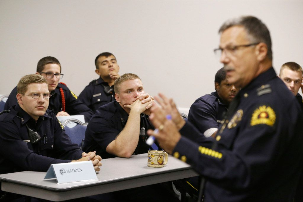 Bryan Madden (left) and Garrett Wickens listen as Deputy Chief Jeffrey Cotner teaches an excellence in policing class to a room of recruits at the Dallas Police Department's training facility in Dallas on May 23, 2017.  (Nathan Hunsinger/The Dallas Morning News)