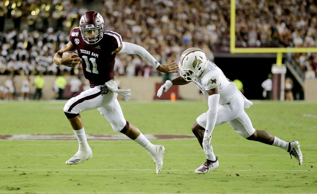 Texas A&M quarterback Kellen Mond (11) fights off Texas State defensive back Jarron Morris (15) while rushing for a touchdown during the first half of an NCAA college football game Thursday, Aug. 29, 2019, in College Station, Texas. (AP Photo/Sam Craft)