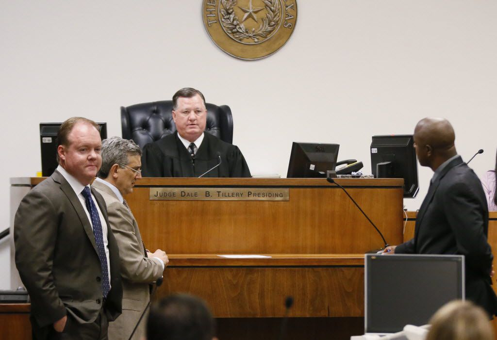Judge Dale B. Tillery, center, talks with attorneys from both side during a hearing in the Jerry Jones sexual harassment civil lawsuit at the George L Allen Sr Courts Building in Dallas, TX on Sept. 26, 2014. From left to right, Levi McCathern, defendant attorney for Jerry and Cowboys, Gregory Shamoun, defendant attorney for Jerry Jones and plaintiff attorney, Thomas Bowers, far right.