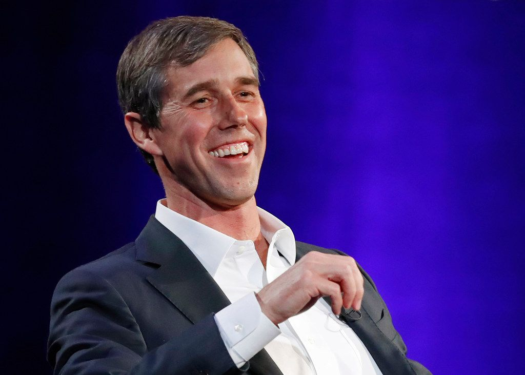 "In this Tuesday, Feb. 5, file photo, former Democratic Texas congressman Beto O'Rourke laughs during a live interview with Oprah Winfrey on a Times Square stage at ""SuperSoul Conversations,"" in New York."