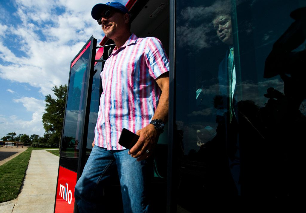 Texas Rangers Manager Jeff Banister and Arlington Mayor Jeff Williams exit Milo, a free driverless shuttle service that will operate on select streets in the Entertainment District, during a demonstration Friday at Globe Life Park.