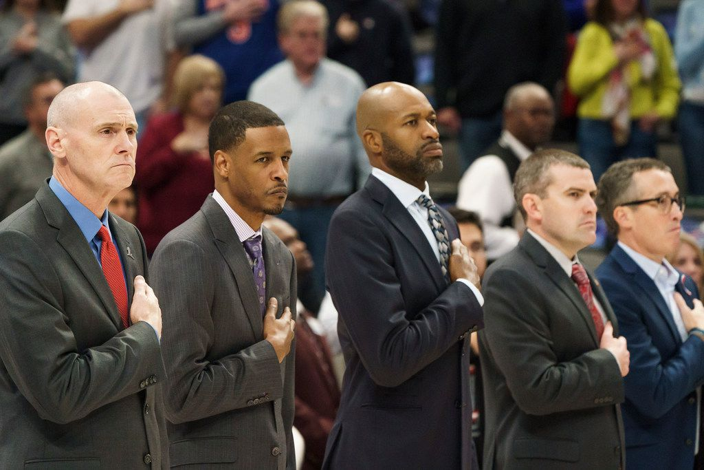 Dallas Mavericks coaches, including head coach Rick Carlisle (left) stand for the national anthem before an NBA basketball game against the New York Knicks at American Airlines Center on Friday, Nov. 8, 2019, in Dallas. (Smiley N. Pool/The Dallas Morning News)