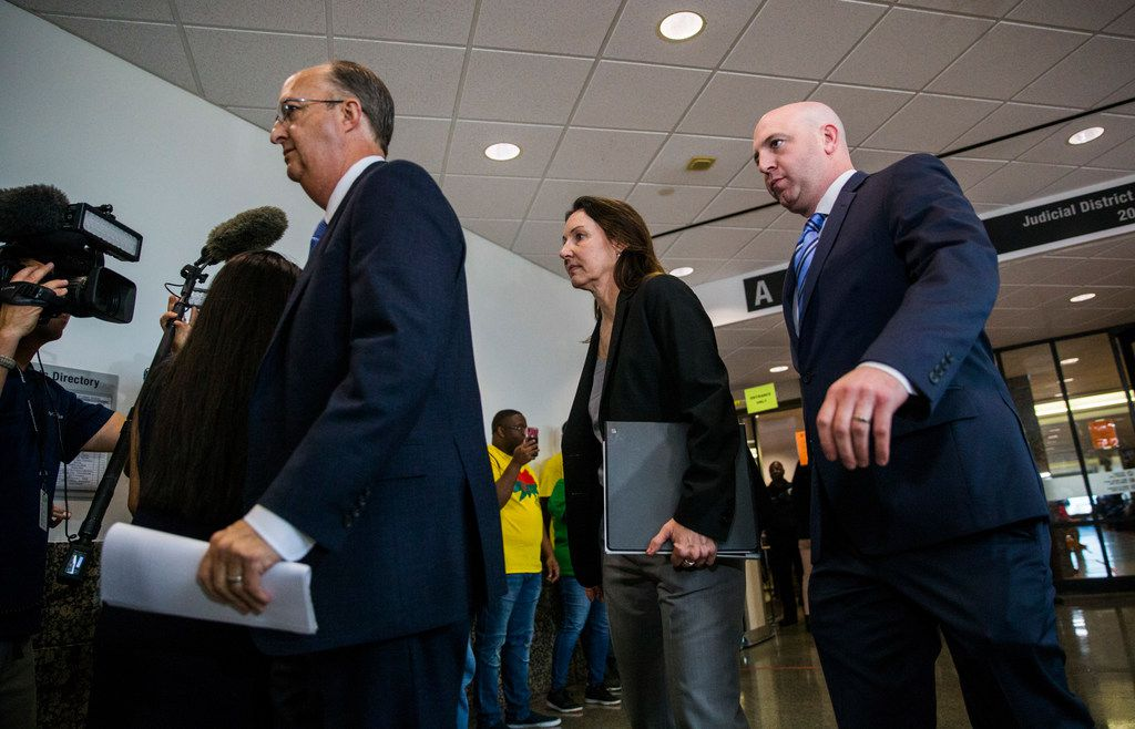 Attorneys representing former Dallas police Officer Amber Guyger leave the courtroom after Guyger was found guilty of the murder of Botham Jean on October 1, 2019, at the Frank Crowley Courts Building in Dallas.
