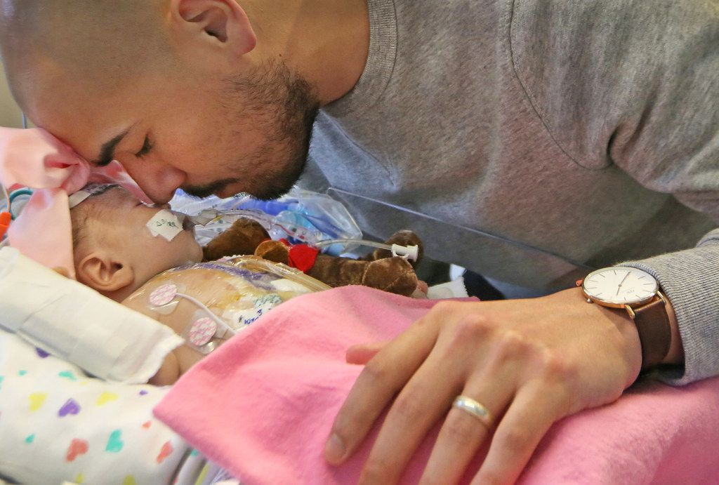 Dallas ISD trustee Miguel Solis spent a quiet moment with daughter Olivia in intensive care at Children's Medical Center on March 20.