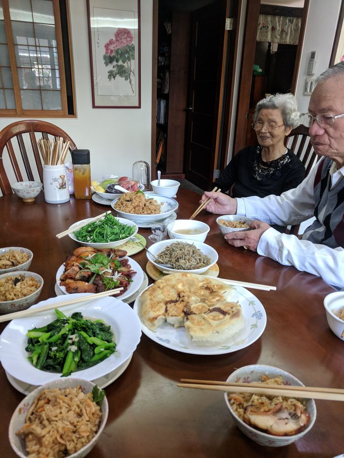 A typical lunch spread at the author's grandmother's home in Taipei, Taiwan. The author's grandmother and grandfather, at right.