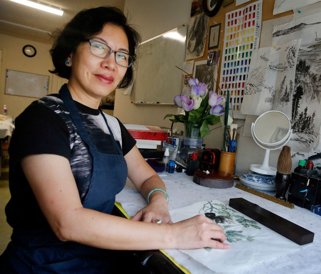 Artist Jenney Chang poses for a photo in her Plano home studio on Aug. 11, 2019. Chang has taught Chinese painting in the Dallas-Fort Worth area for over two decades