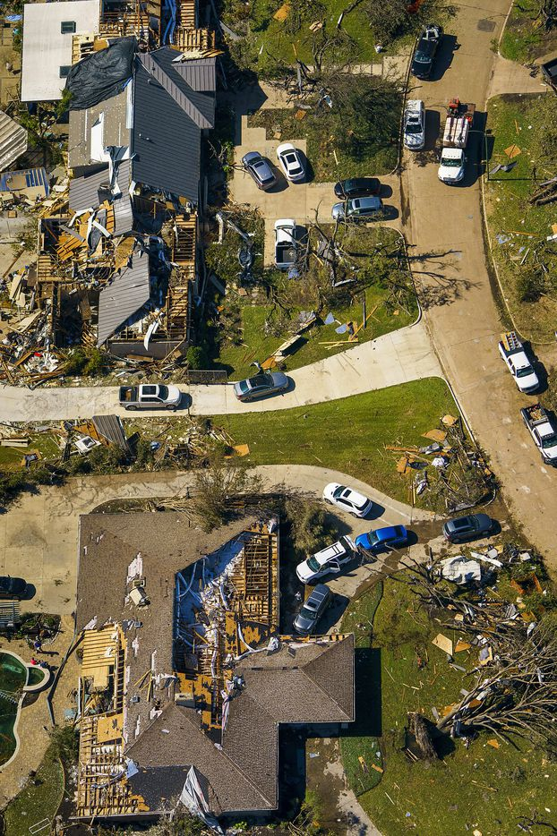 People work amidst tornado damage near Walnut HIll Lane and Mash Lane in Monday, Oct. 21, 2019, in Dallas.