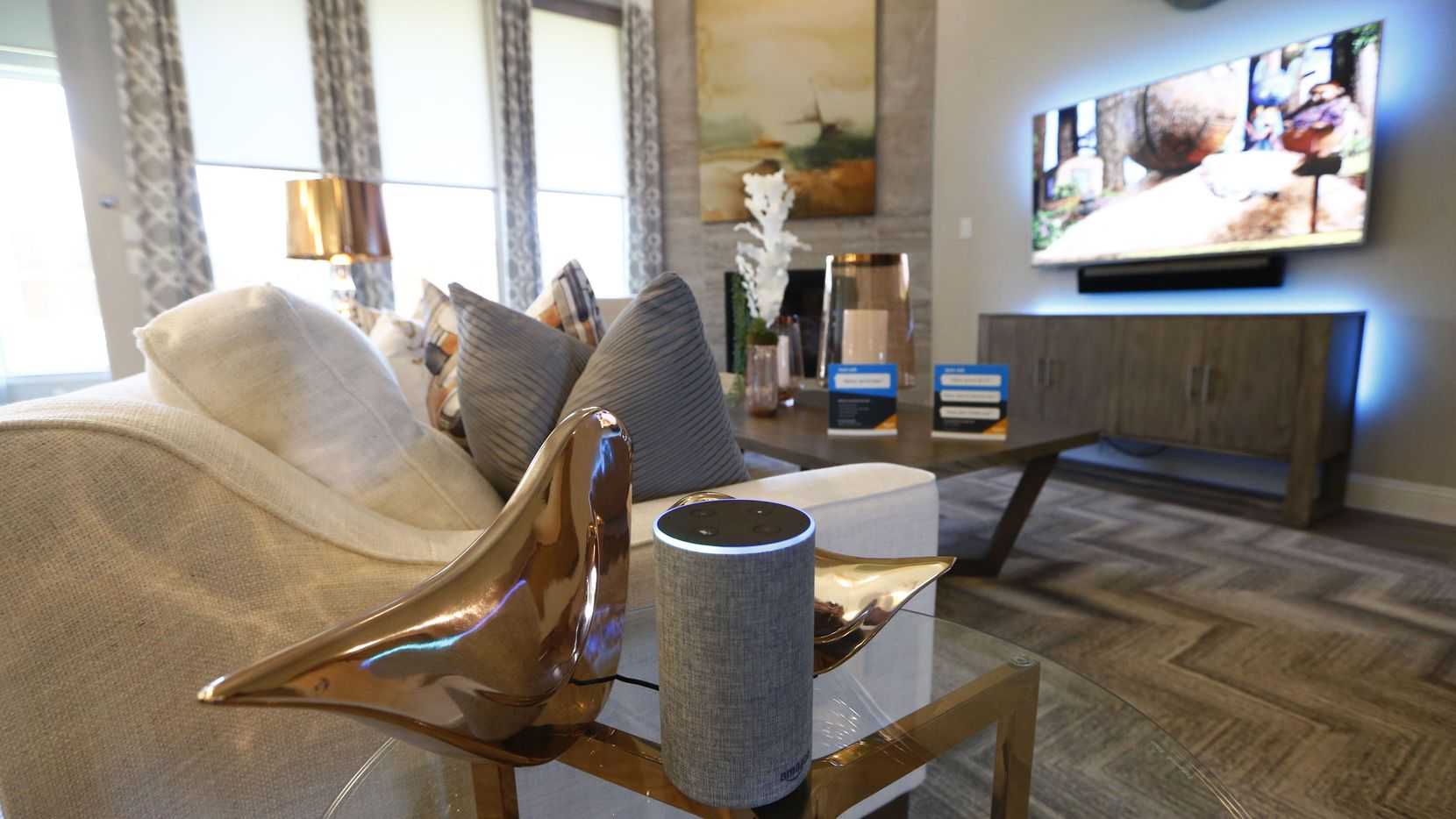 An Amazon Experience Centers model home built by Lennar in Dallas features a second-generation Amazon Echo that controls the window blinds as well as televisions and lighting.