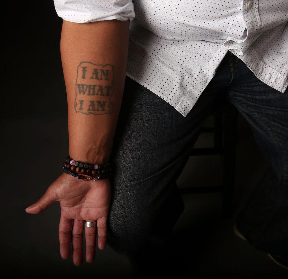 "Trenton Johnson has a tattoo reading, ""I am what I am."" (Rose Baca/The Dallas Morning News)"