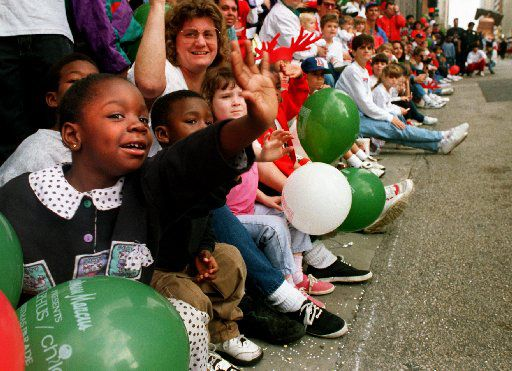 Dec. 2, 1995: Ashley Herog, 6,  waves to a Casper balloon at the Adolphus Children's Christmas Parade on Commerce  Street.