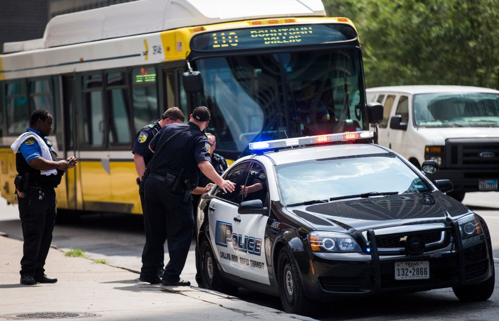 DART officers work near a DART police car on Thursday, August 3, 2017 near the West End DART station in downtown Dallas. (Ashley Landis/The Dallas Morning News)