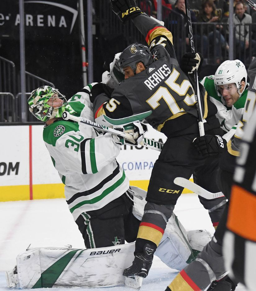 LAS VEGAS, NEVADA - FEBRUARY 26:  Ben Lovejoy #21 of the Dallas Stars pushes Ryan Reaves #75 of the Vegas Golden Knights into Ben Bishop #30 of the Dallas Stars in the second period of their game at T-Mobile Arena on February 26, 2019 in Las Vegas, Nevada. The Golden Knights defeated the Stars 4-1.  (Photo by Ethan Miller/Getty Images)