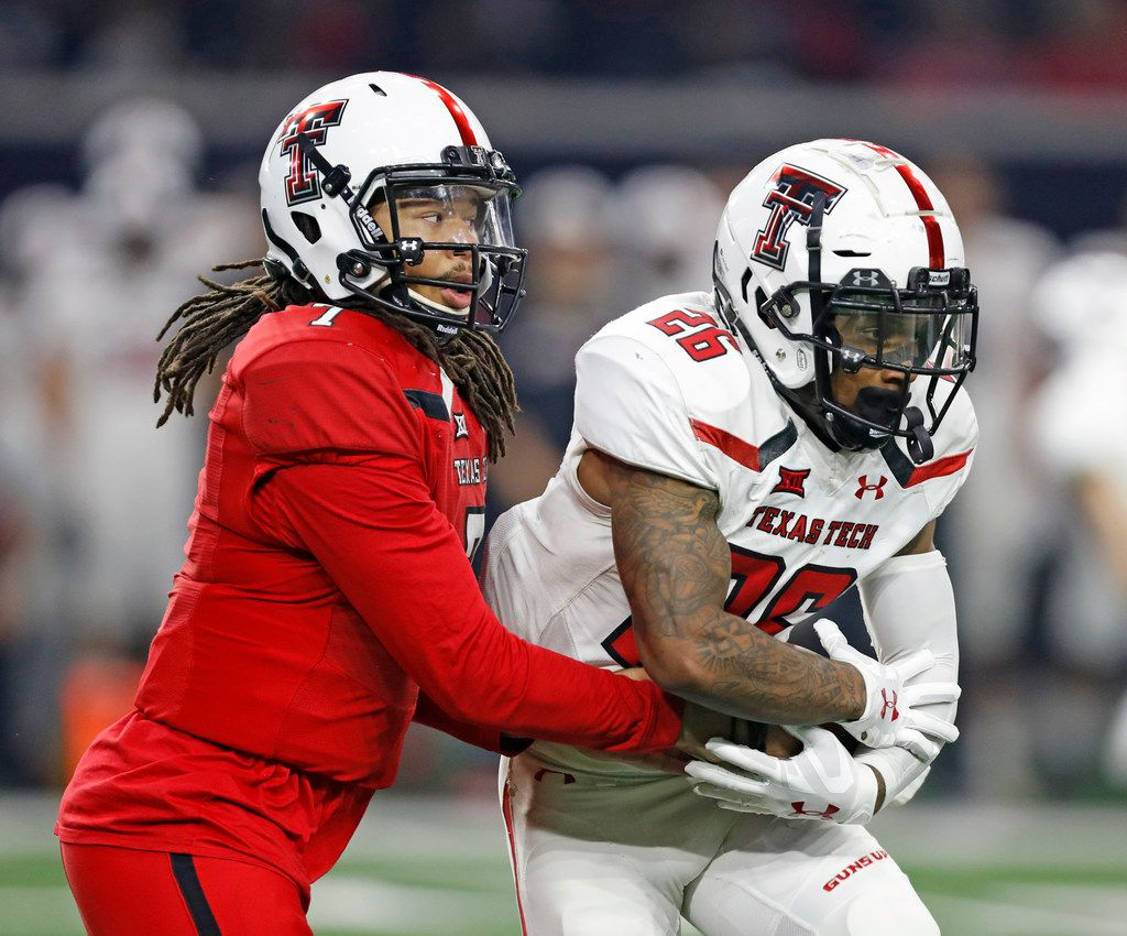 Texas Tech's Jett Duffey (7) hands the ball off to Ta'Zhawn Henry (26) during an NCAA college football spring game, Saturday, April 13, 2019, in Frisco, Texas. (Brad Tollefson/Lubbock Avalanche-Journal via AP)