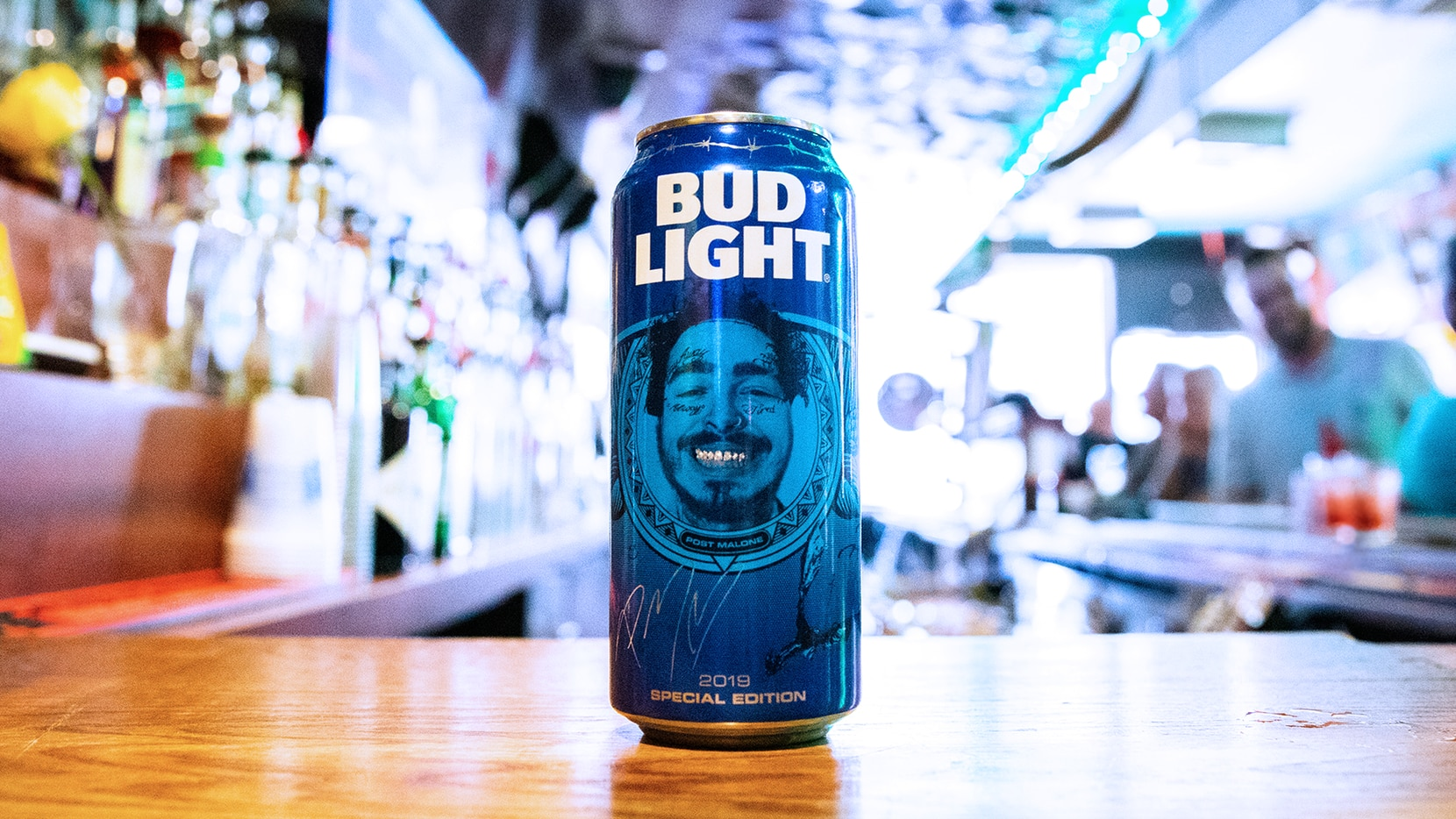 Post Malone's face is printed on Bud Light cans in 2019.