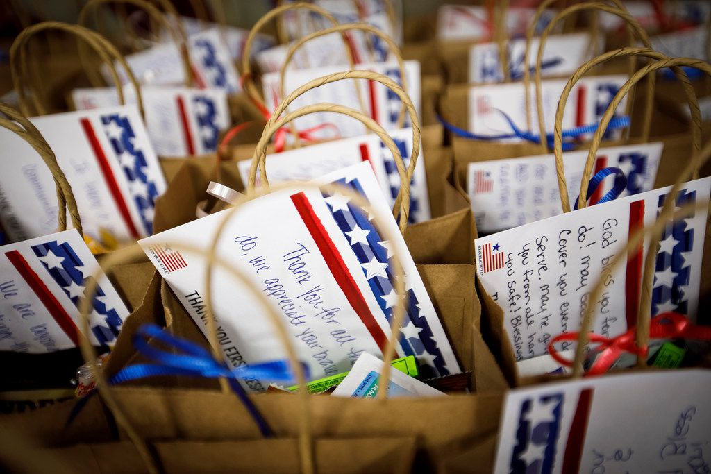 Republic Title employees pack gifts/notes of encouragement to first responders in honor of the 9/11 Day of Service on Monday, Sept. 11, 2017, in Dallas. (Smiley N. Pool/The Dallas Morning News)