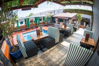 The Whiskey Garden's courtyard is home to more than just the pool; there's booth-style seating above the swim-up bar. The view makes it a perfect vantage point to keep an eye on the action below.