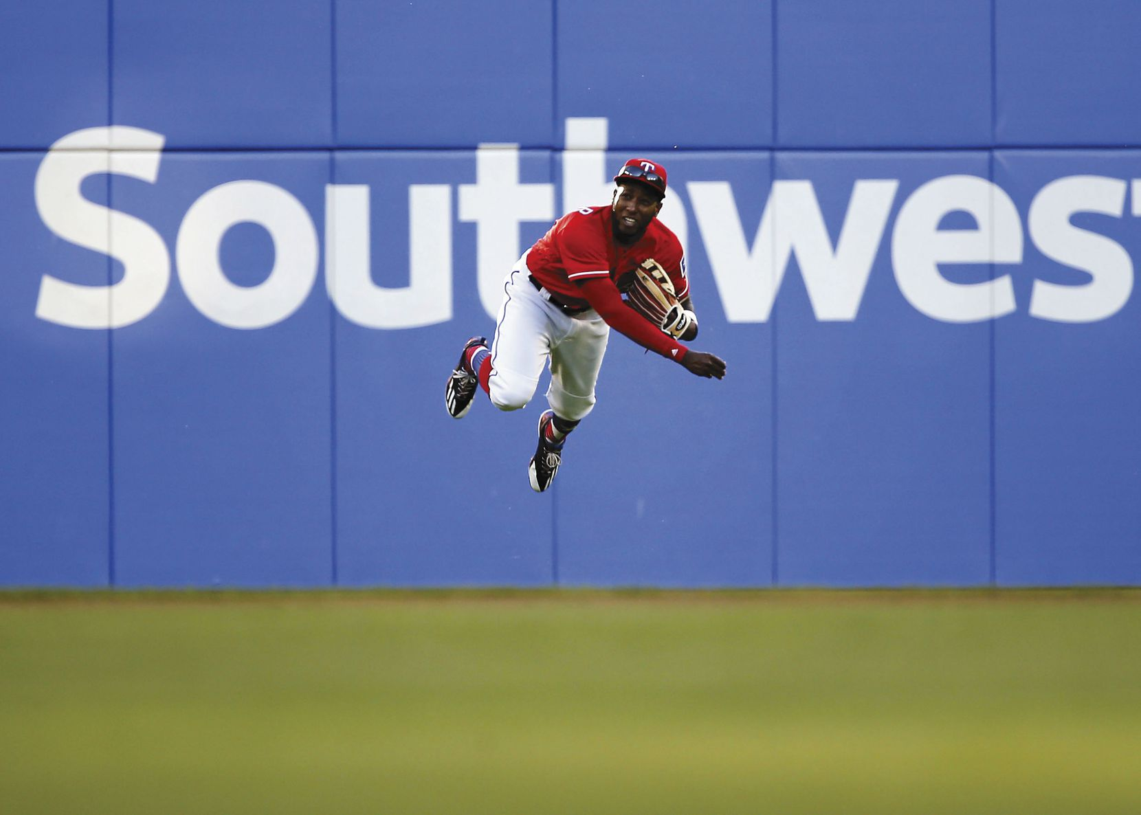 Rangers left fielder Jurickson Profar goes flying to return a ball in the third inning against the Indians on Opening Day on April 3.