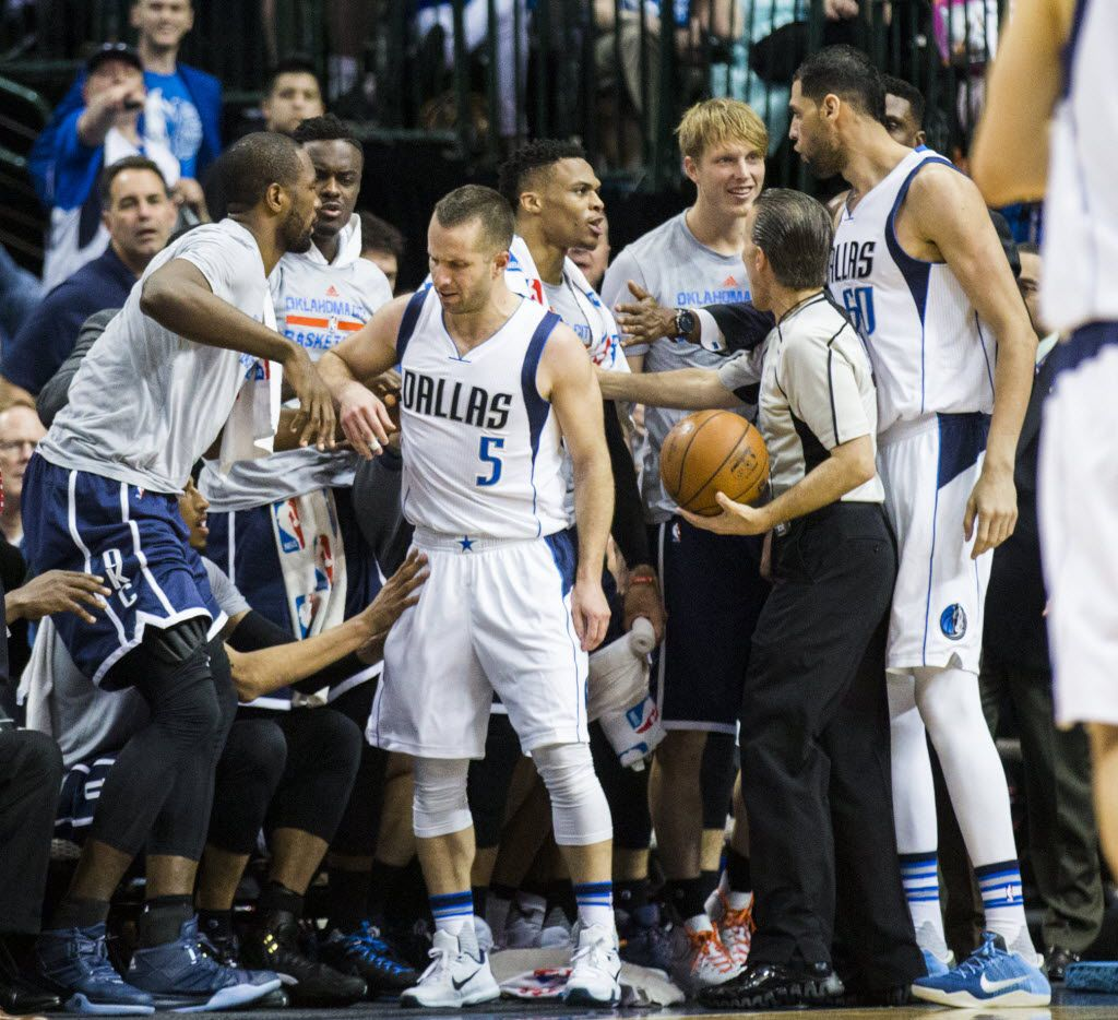 Dallas Mavericks guard J.J. Barea (5), center Salah Mejri (50) and referee Ken Mauer (41) hold off Oklahoma City Thunder players at the bench during a skirmish in the second quarter of game 4 of their series in the first round of NBA playoffs on Saturday, April 23, 2016 at the American Airlines Center in Dallas.  (Ashley Landis/The Dallas Morning News)