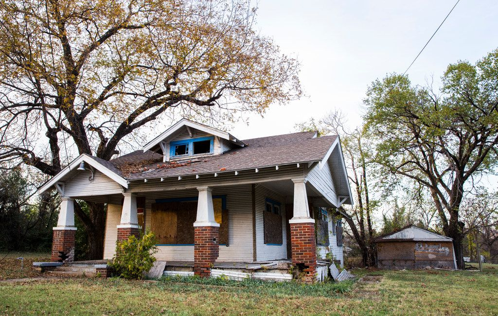 This 125-year-old house at 1107 E 11th St., built in the late 1800s, is on the city's to-tear-down list.