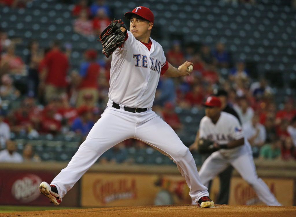 Texas Rangers starting pitcher Derek Holland (45) throws a pitch during the Los Angeles Angels vs. the Texas Rangers major league baseball game at Globe Life Park in Arlington on Thursday, October 1, 2015. (Louis DeLuca/The Dallas Morning News)