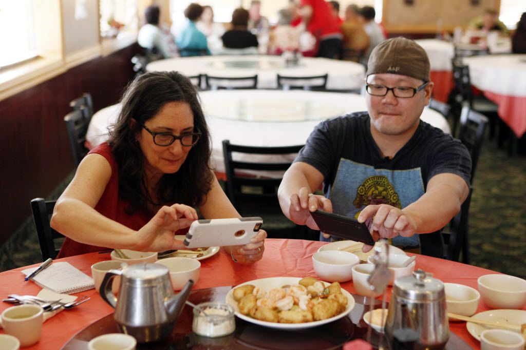 "Restaurant critic Leslie Brenner and FT33 line cook Chih-Ming ""Petey"" Feng snap smartphone photos of the shrimp with fried milk custard."