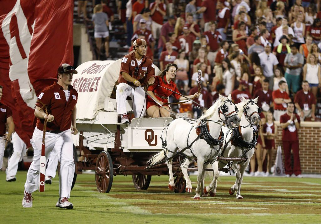 The Oklahoma Sooner Schooner is driven out onto the field following an Oklahoma touchdown against Louisiana Tech in the fourth quarter of an NCAA college football game in Norman, Okla., Saturday, Aug. 30, 2014. Oklahoma won 48-16. (AP Photo/Sue Ogrocki) 11072014xBRIEFING