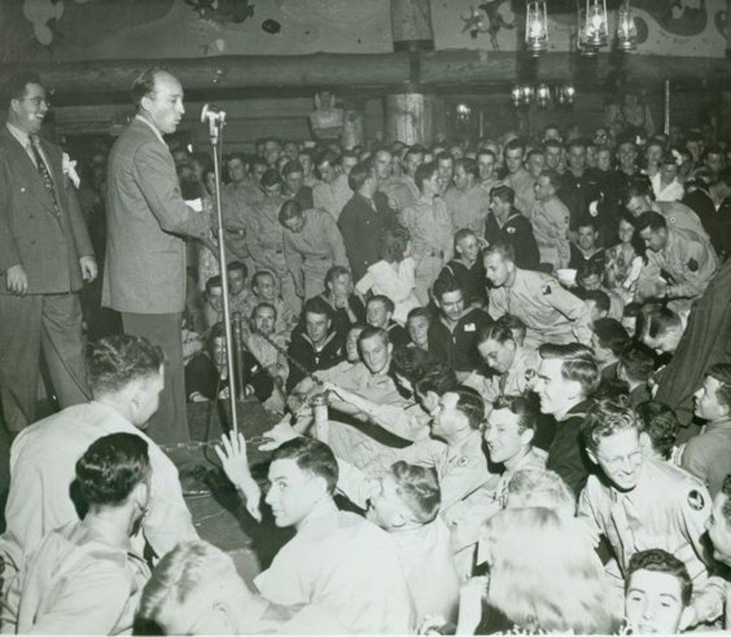 Bing Crosby, backed by John Scott Trotter, at the Hollywood Canteen in 1944. From Bing Crosby: Swinging on a Star, by Gary Giddins.