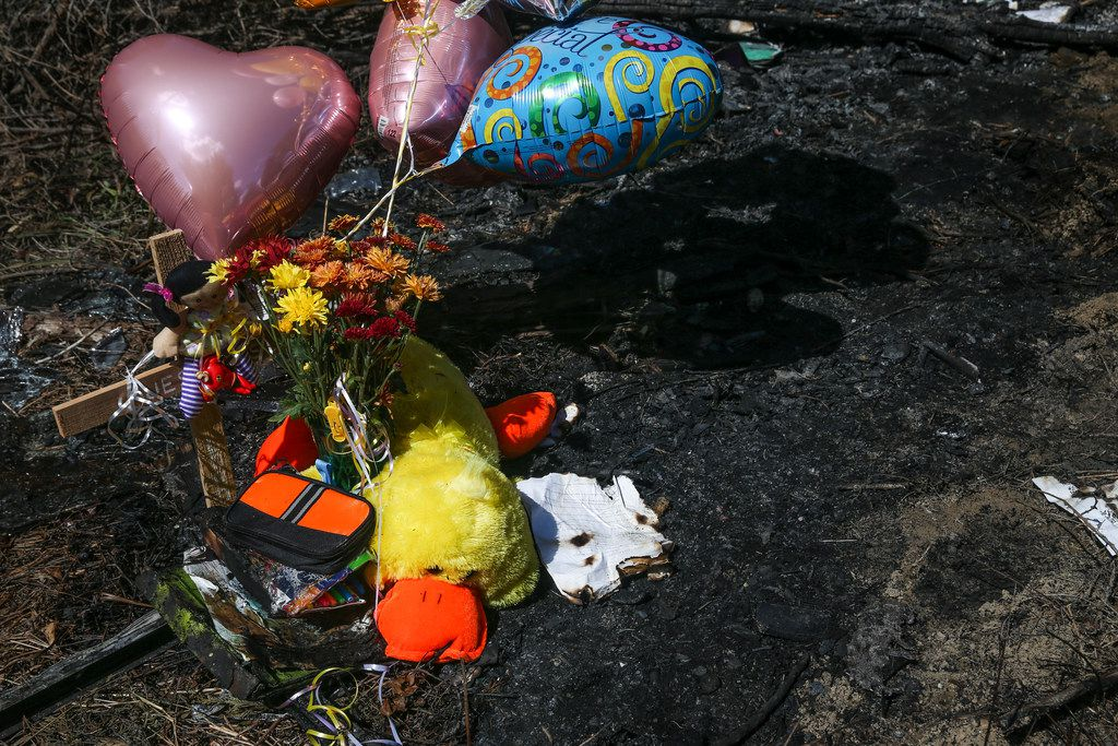 Balloons fly at the site of a memorial where one student died Wednesday when a Mesquite ISD school bus rolled into a ditch with 40 students on board in the 3500 block of Lawson Road on Thursday, Oct. 4, 2018 in Mesquite, Texas. (Ryan Michalesko/The Dallas Morning News)