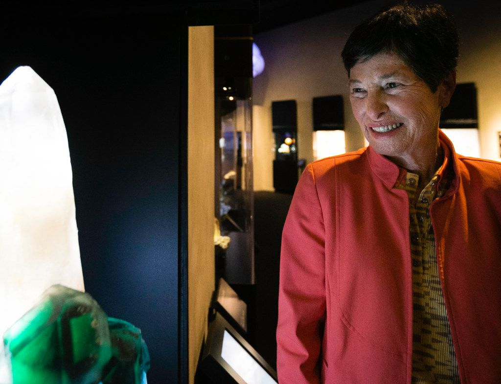 """Lyda Hill admires """"The Eye of Africa""""€ mineral on display in the Lyda Hill Gems and Minerals Hall at the Perot Museum of Nature and Science in Dallas on Wednesday, July 12, 2017. (Tailyr Irvine/The Dallas Morning News)"""