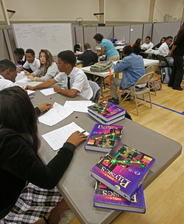 Students work in class during the school day at Focus Learning Academy charter school, located on Ledbetter Road in Dallas. (Louis DeLuca/The Dallas Morning News)