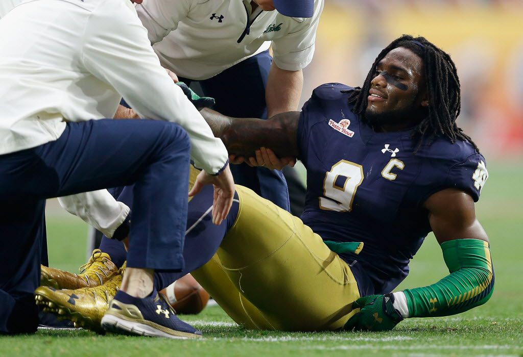 GLENDALE, AZ - JANUARY 01:  Linebacker Jaylon Smith #9 of the Notre Dame Fighting Irish lays on the field after an injury during the first quarter of the BattleFrog Fiesta Bowl against the Ohio State Buckeyes at University of Phoenix Stadium on January 1, 2016 in Glendale, Arizona.  The Buckeyes defeated the Fighting Irish 44-28.  (Photo by Christian Petersen/Getty Images) ORG XMIT: 595507163