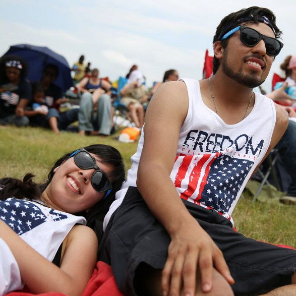 Giselle Cardenas (left), of Longview, and boyfriend, Danny Calvillo (right), of Longview, look toward the stage during Celebrate Freedom, an annual outdoor Christian music concert, at Southfork Ranch in Parker, Texas Saturday June 28, 2014.