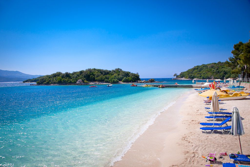The Albanian town of Ksamil has a party vibe, with beach clubs dotting the coastline. From here, you can swim to three small islands offshore, floating in the Mediterranean next to revelers' giant inflatable unicorns and paddleboats with slides.