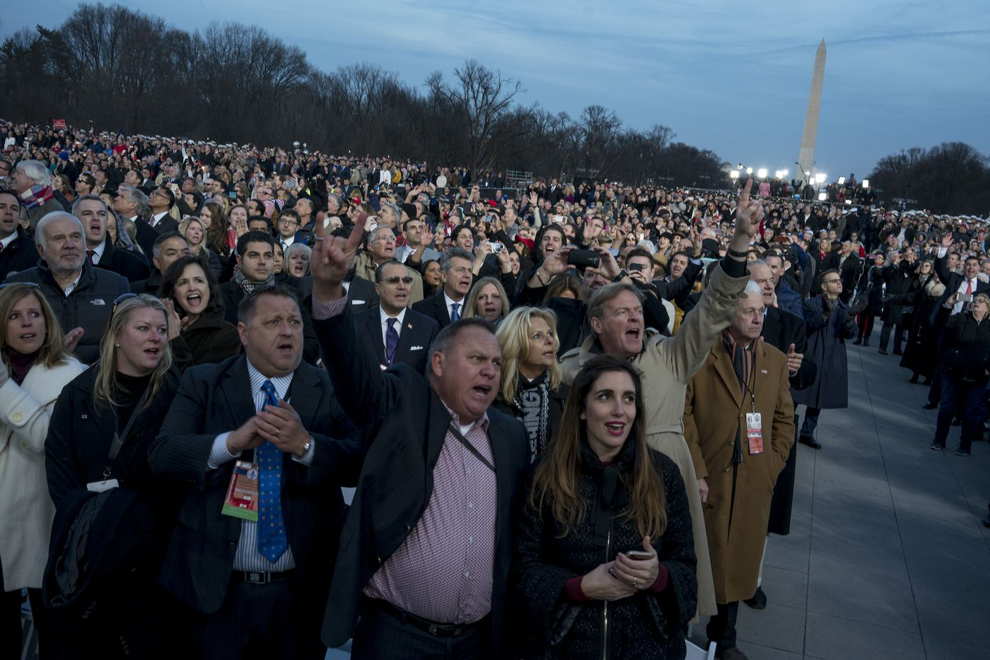 Guests cheer during the inauguration concert at the Lincoln Memorial January 19, 2017 in Washington, DC. Hundreds of thousands of people are expected tomorrow for Trump's inauguration as the 45th president of the United States.