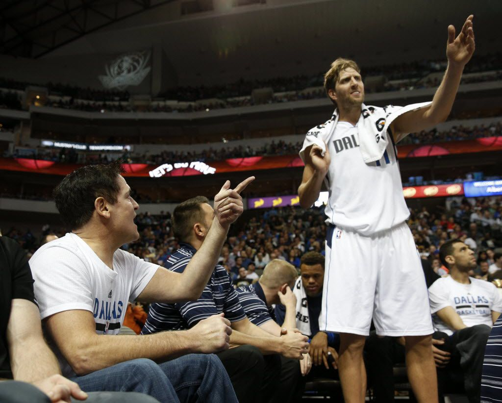 Dallas Mavericks owner Mark Cuban talks to Dallas Mavericks forward Dirk Nowitzki (41) during the second period against the Minnesota Timberwolves at the American Airlines Center in Dallas on Feb. 28, 2016. (Rose Baca/The Dallas Morning News)