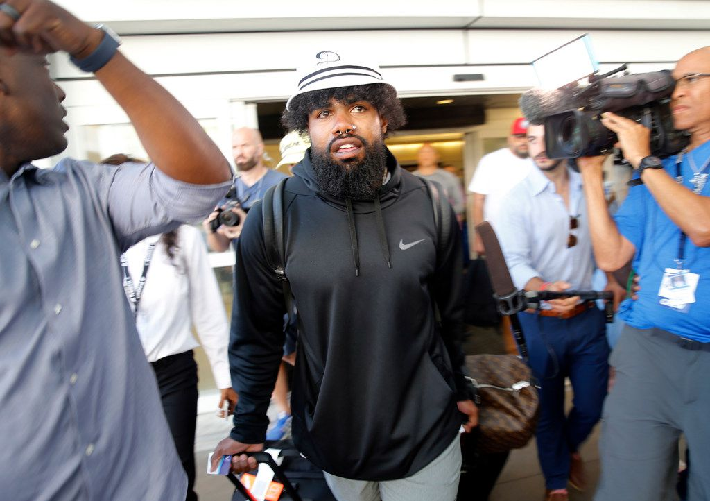 Dallas Cowboys running back Ezekiel Elliott arrived at Dallas Fort Worth International Airport after arriving back from Mexico, Tuesday, September 3, 2019. Elliott has been holding out for a new contract from the Cowboys. (Tom Fox/The Dallas Morning News)