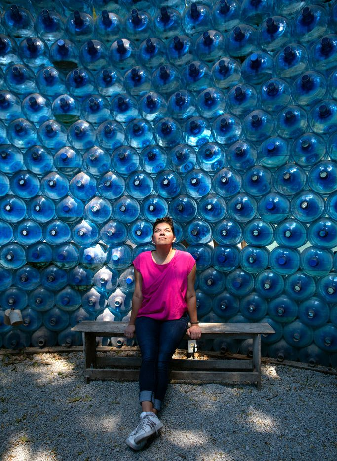 Leslie Moody Castro, who splits her time between Texas and Mexico, poses in a structure made of recovered water bottles in the community space Huerto Roma Verde in the Roma Norte neighborhood of Mexico City.