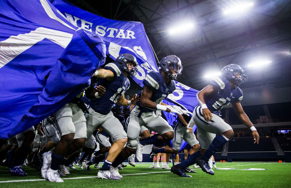 Frisco Lone Star football players run on the field before a District 5-5A Division I high school football game between Frisco Independence and Frisco Lone Star on Thursday, October 10, 2019 at the Ford Center at The Star in Frisco. (Ashley Landis/The Dallas Morning News)
