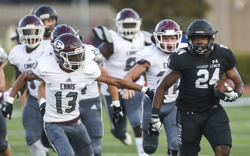 Bishop Lynch running back Darries Boyd (24) makes a run downfield as Ennis defensive back Cam'Ren Stevens (13) reaches to attempt a stop during a high school football game between Bishop Lynch and Ennis on Friday, Sept. 6, 2019 in Dallas. (Ryan Michalesko/The Dallas Morning News)