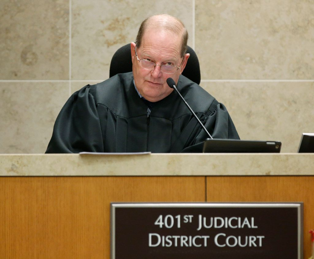 District Judge Mark Rusch addresses the court during the trial of Enrique Arochi in September 2016.