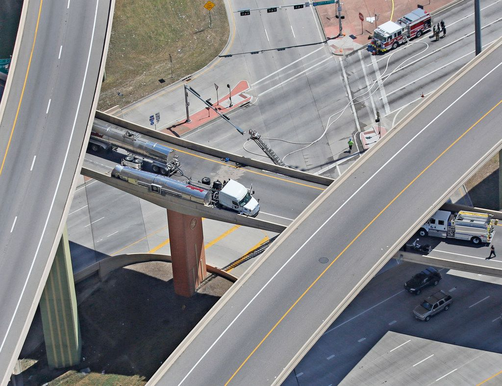 The Intersection of Interstate 635 and Highway 75 north of downtown Dallas remains closed after an overturned truck carrying hazardous materials crashed. Photographed on Thursday, June 21, 2018. (Louis DeLuca/The Dallas Morning News)