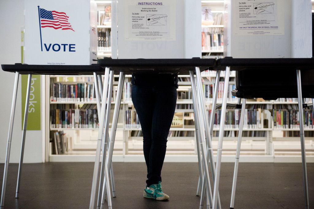A voter takes advantage of early voting opportunities at a library.