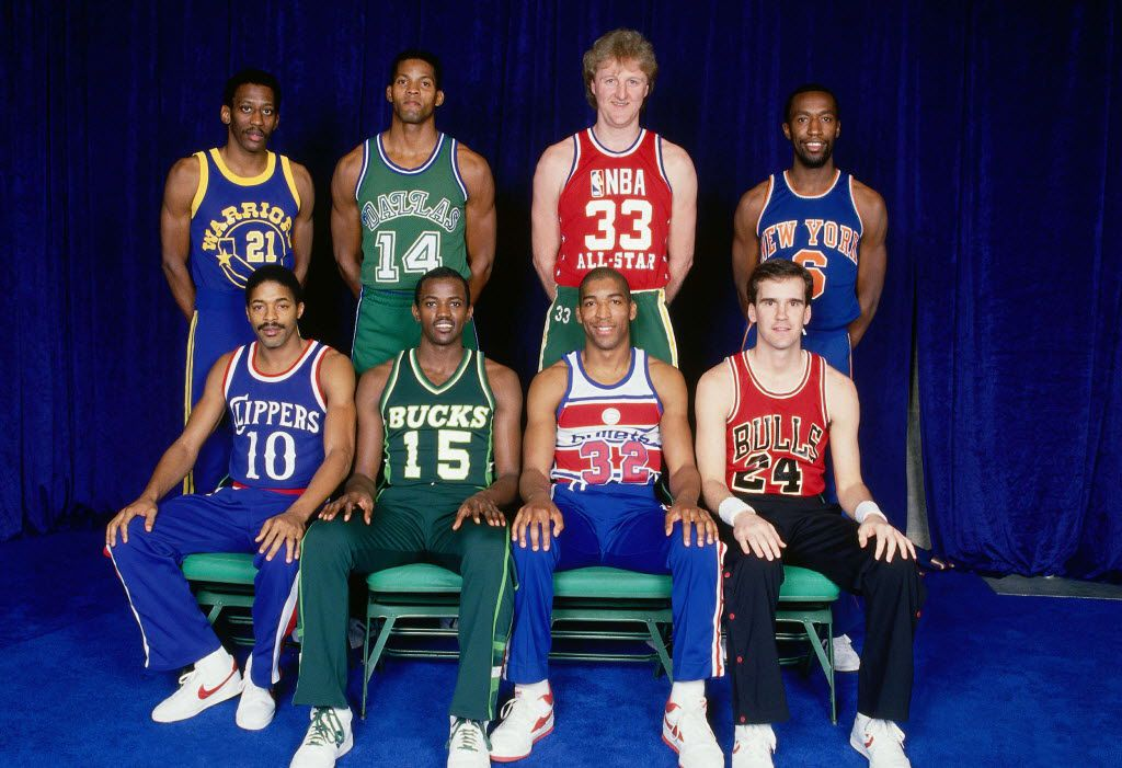 "DALLAS - FEBRUARY 8:  Front Row (L-R):  Norm Nixon, Craig Hodges, Leon Wood, Kyle Macy, Back Row (L-R) - Eric ""Sleepy"" Floyd, Dale Ellis, Larry Bird and Trent Tucker pose for a portrait prior to the 1986 Three Point Competition at Reunion Arena in Dallas Texas. NOTE TO USER: User expressly acknowledges that, by downloading and or using this photograph, User is consenting to the terms and conditions of the Getty Images License agreement. Mandatory Copyright Notice: Copyright 1986 NBAE (Photo by Andrew D. Bernstein/NBAE via Getty Images)"
