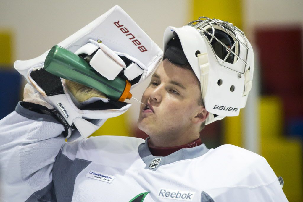 FILE - Goalie Jake Oettinger gets a drink of water between drills on the first day of Dallas Stars development camp at the Dr Pepper StarCenter on Saturday, July 8, 2017, in Frisco.