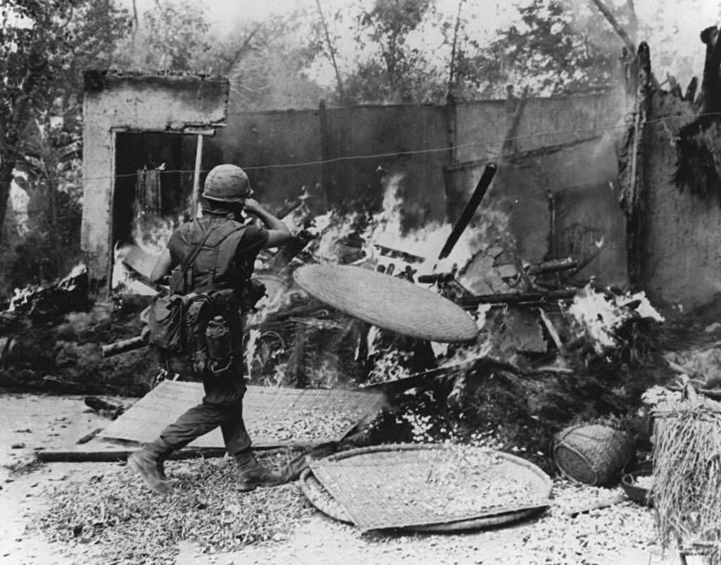 Ron Haberle's photos of My Lai were published in The Cleveland Plain Dealer more than a year after the events of March 16, 1968. Pictured: A soldier burning down a hut in My Lai village. (Ron Haberle courtesy of National Archives)