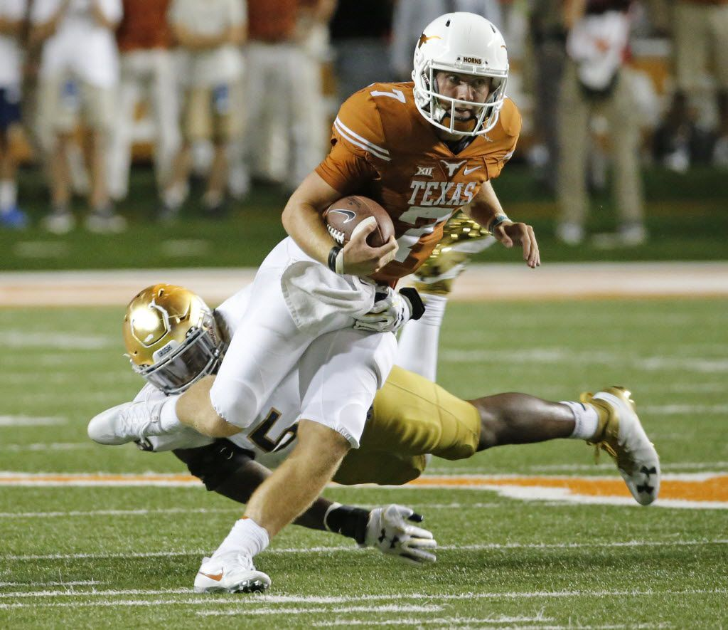 Texas quarterback Shane Buechele (7) scrambles for yardage in the fourth quarter during the Notre Dame Fighting Irish vs. the University of Texas Longhorns NCAA football game at Darrell K. Royal Memorial Stadium in Austin on Sunday, September 4, 2016. (Louis DeLuca/The Dallas Morning News)