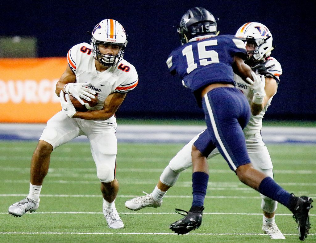 FILE - Wakeland High School wide receiver Kevin Rychel (5) looks for room to run as Lone Star High School outside linebacker Toren Pittman (15) looks for an angle to make the tackle during the first half as Lone Star High School hosted Wakeland High School at The Star in Frisco on Friday evening, October 5, 2018.  (Stewart F. House/Special Contributor)