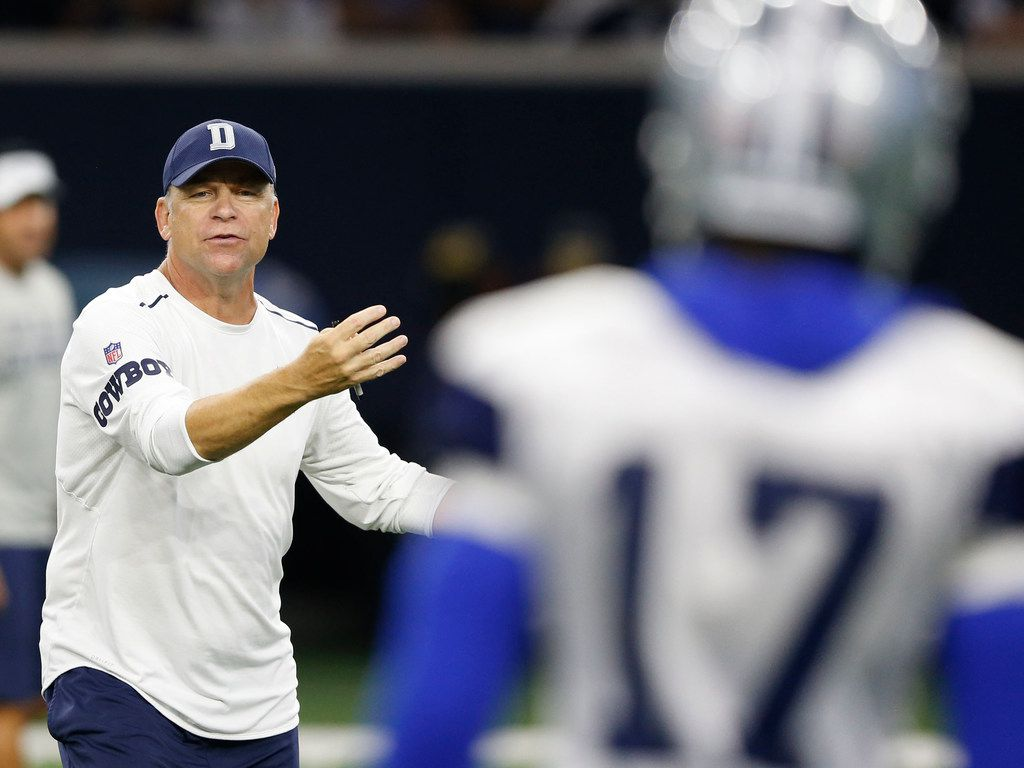 Dallas Cowboys offensive coordinator Scott Linehan talks with Dallas Cowboys wide receiver Allen Hurns (17) during practice at Dallas Cowboys training camp at The Star in Frisco, Texas on Tuesday, August 28, 2018. (Vernon Bryant/The Dallas Morning News)