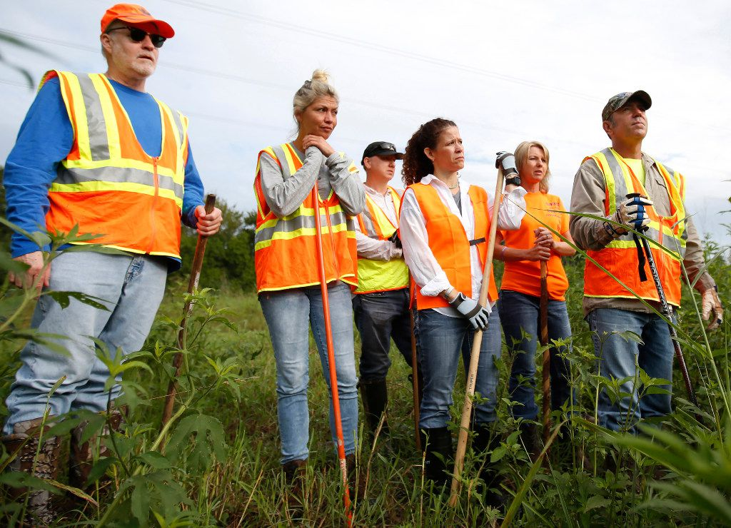 Mark Morris (right), the father of Christina Morris, prepared to enter a wooded area as they searched for Christina Morris in rural Collin County last August. From left are Greg Modrall, Kellie Castle, Clint Jenkins, Sheri Morris, Angel Jenkins and Mark Morris.