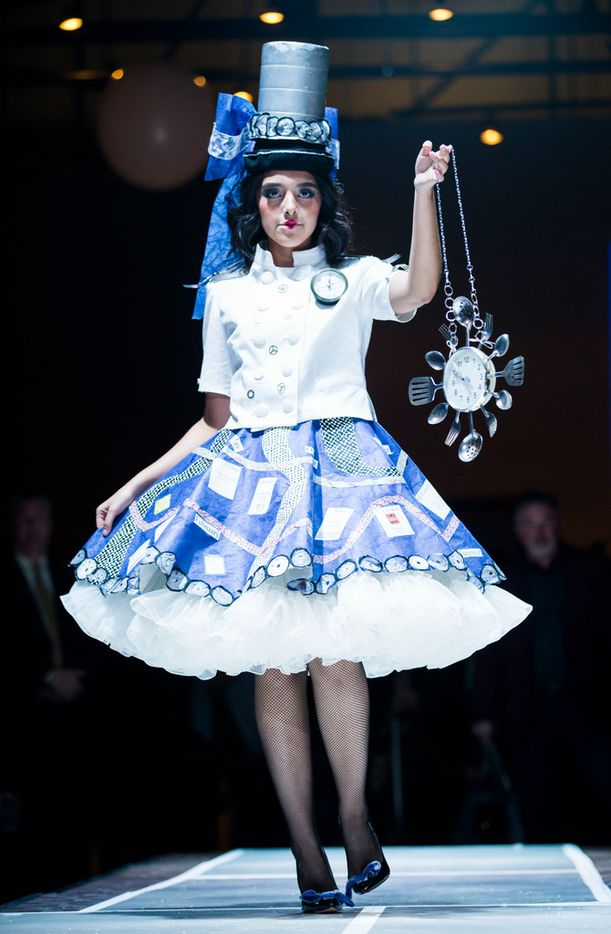 A model wears an outfit accented with kitchen items during the Greater Dallas Restaurant Association's Food in Fashion event on Wednesday, Feb. 7, 2018, at Trinity Groves in Dallas. The designer was Diana Beard.